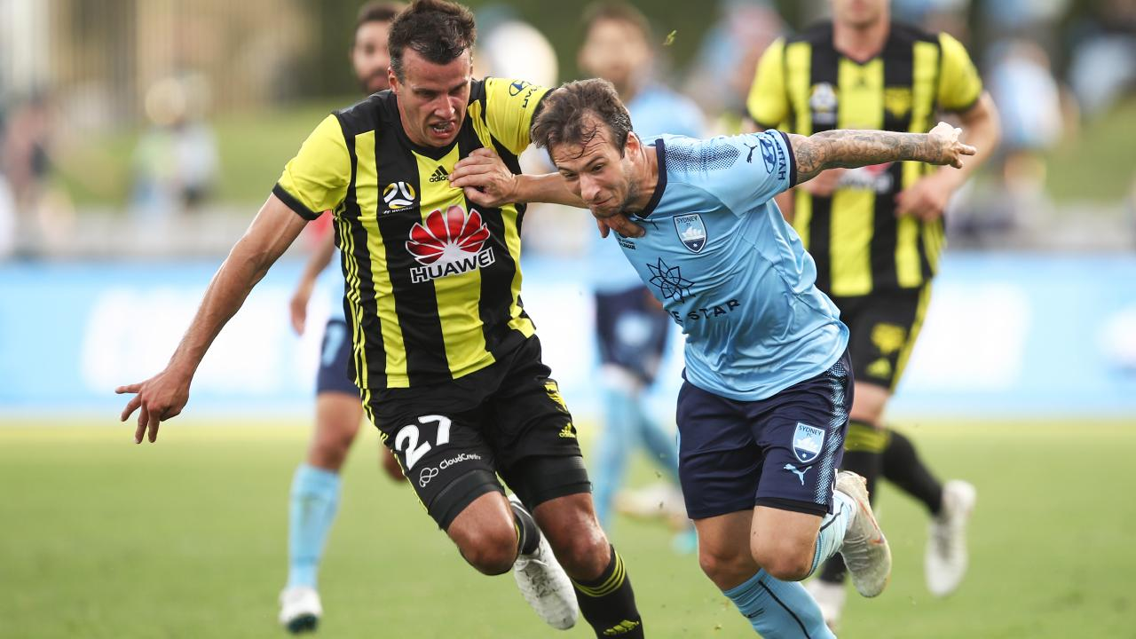 Adam Le Fondre of Sydney competes with Steven Taylor of the Phoenix