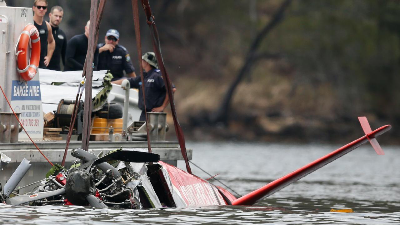 Pictured at Jerusalem Bay in Sydneys Hawkesbury river are police attached to Marine Area Command, during an operation to recover the wreckage of a Sydney Seaplane that crash into the water on New Year's Eve. Picture: Richard Dobson.