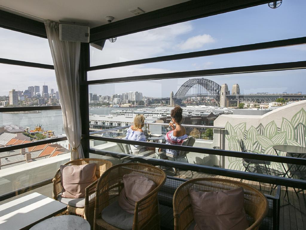 File photo of women enjoying drinks on the roof top bar of the Palisade Hotel in the Rocks. Picture: Tim Pascoe