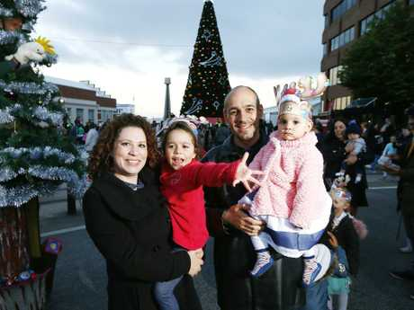 The Santos family of Blackmans Bay at the lighting of the Christmas tree at Mawson Pavillion, Hobart. Picture: Matt Thompson