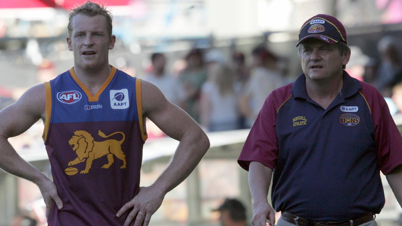Former Brisbane Lions premiership star Michael Voss and sports psychologist Phil Jauncey walk the boundary during Lions match at the Gabba in 2005. Jauncey spent 15 seasons with the Lions. Picture: David Kapernick