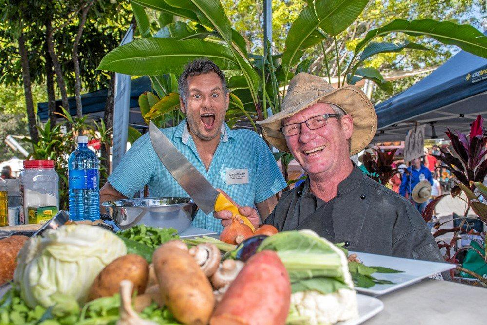That's not a knife... Martin with Peter Wolfe, free-ranging chef and creator of Cedar Creek Bushfood, at Eumundi Market.