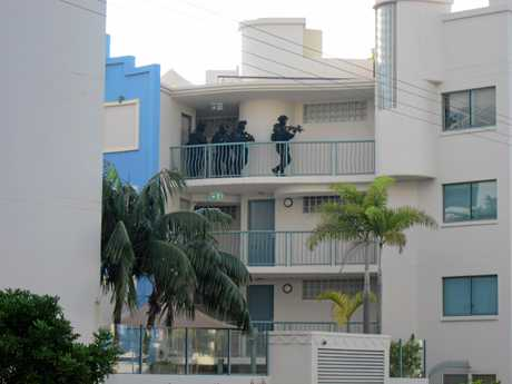 Special Emergency Response Team officers prepare to arrest a man after a 12-hour siege at Grand Palais Beachside Resort in Alexandra Headland in April 2014.
