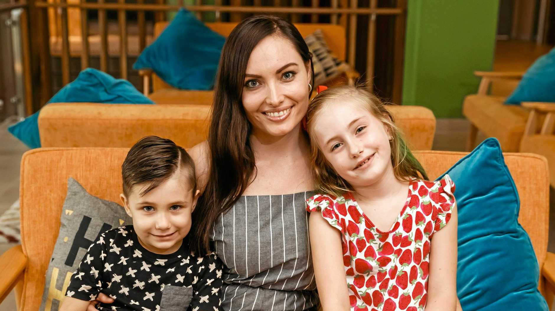 BRAVE BATTLE: Ronald McDonald House resident Pamela Pershouse at The Star Entertainment Group's charity buffet in Brisbane, along with her daughter Leah, 6, and son Tyler, 4, who was diagnosed with a rare cancer.