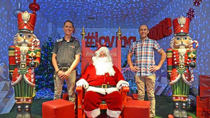 SANTA'S SUCCESS: Acting City Centre Manager Andrew Walker with Lismore Chamber of Commerce & Industry member Rodney Jenkins at Santa's Wonderland in Molesworth Street.