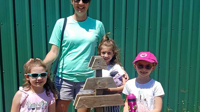 CHRISTMAS: Habana residents, Wendela Schimmer and her daughters Audra, Isla and Keira Missin took a recycled pallet Christmas tree home to decorate and bring back to be used for Habana Carols.