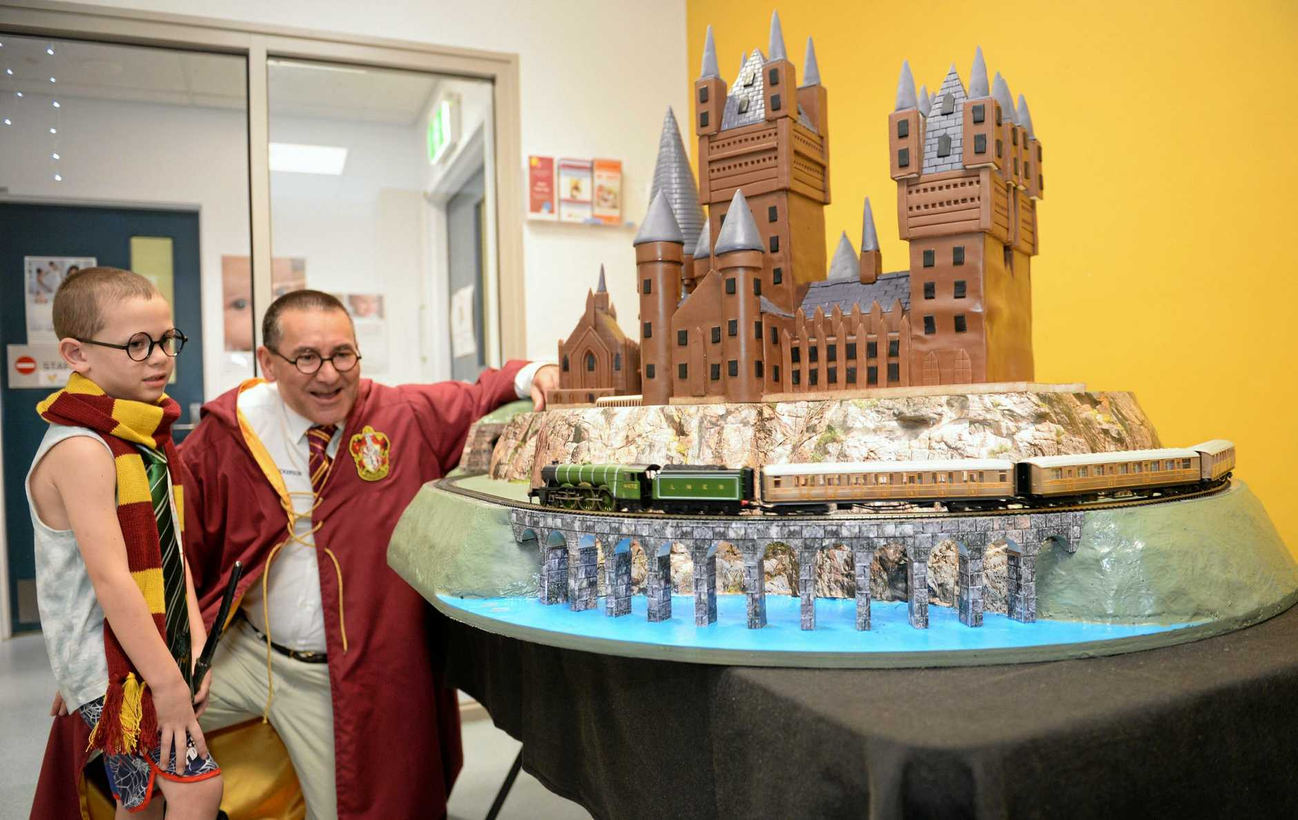 Drew Wickerson and Ja' Tarhmei Anderson with the Hogwarts cakes to Children's Ward at Rockhampton Hospital.