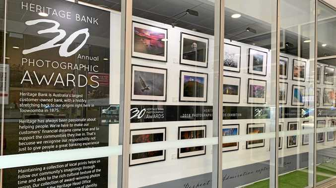 WINNERS: Some of the top 50 photographs from the Heritage Bank Photographic Awards on display in Ruthven St.