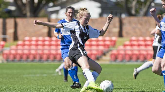 UNBEATEN PREMIERS: Willowburn's Courtney Morris sends the ball downfield during her side's grand final against Rockville. Willowburn created history when they won every regular season and finals game they played earlier this year.