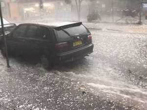River of hail sweeps through Sydney