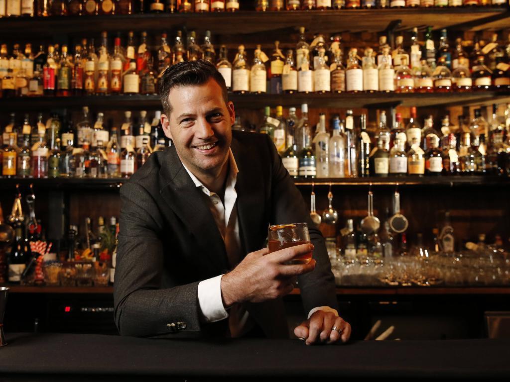 Martin Lange posing at his Savile Row bar. Picture: AAP Image/Josh Woning
