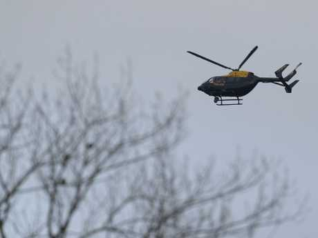 A Police helicopter flies over Gatwick Airport as they search for the Drone operator causing closure of the airport. Picture: Getty