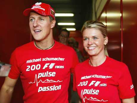 Michael Schumacher of Germany and Ferrari celebrates with his wife Corrina after competing in his 200th Grand Prix during the Spanish F1 Grand Prix on May 9, 2004. Picture: Getty