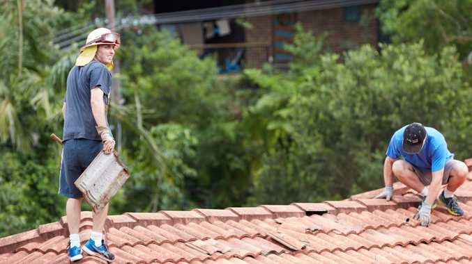 Work has started repairing damage after Thursday's storm in Sydney. Picture: AAP Image/Erik Anderson)