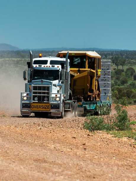 Construction equipment arrives at the Carmichael megaine site.