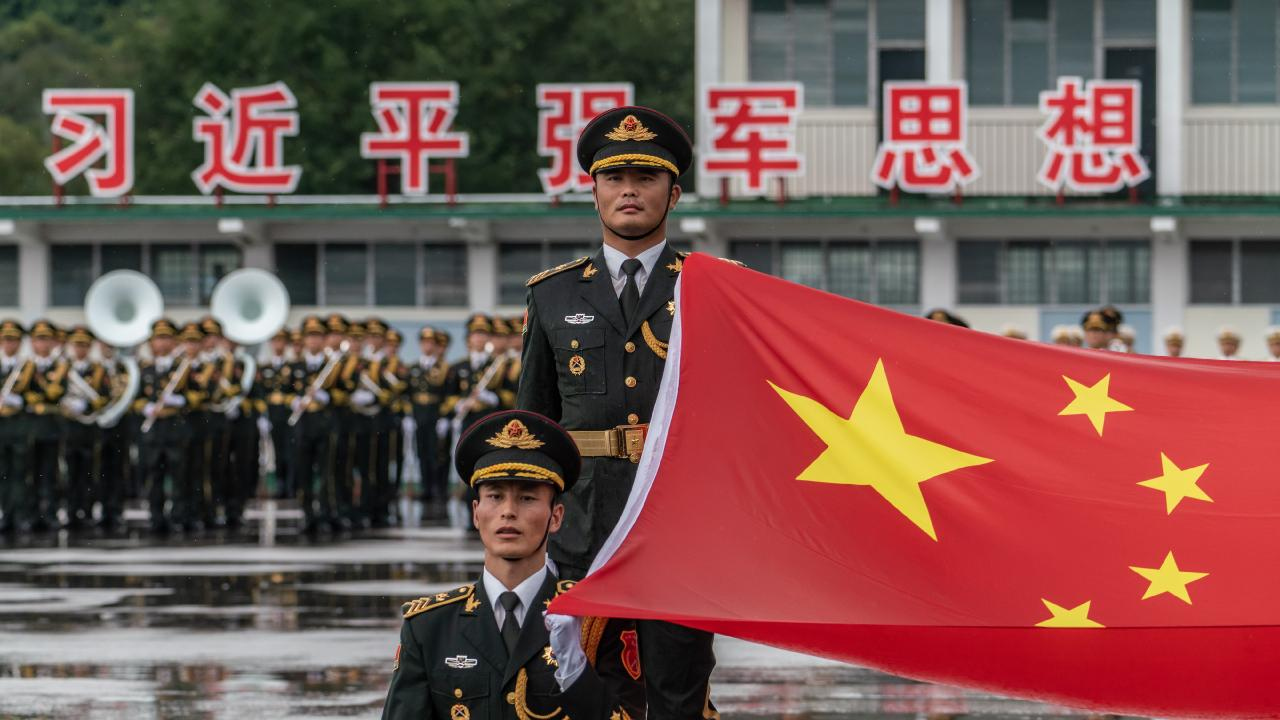 Members of the People's Liberation Army (PLA) attend a flag raising ceremony at the Shek Kong Barracks on June 30, 2018. Picture: Anthony Kwan
