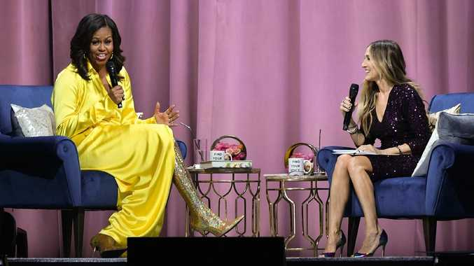 A candid moment between Michelle Obama and SJP in New York. Picture: Getty Images
