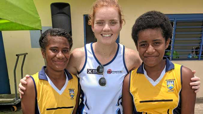 IN FIJI: Stephanie Wood with netball players from Levuka.