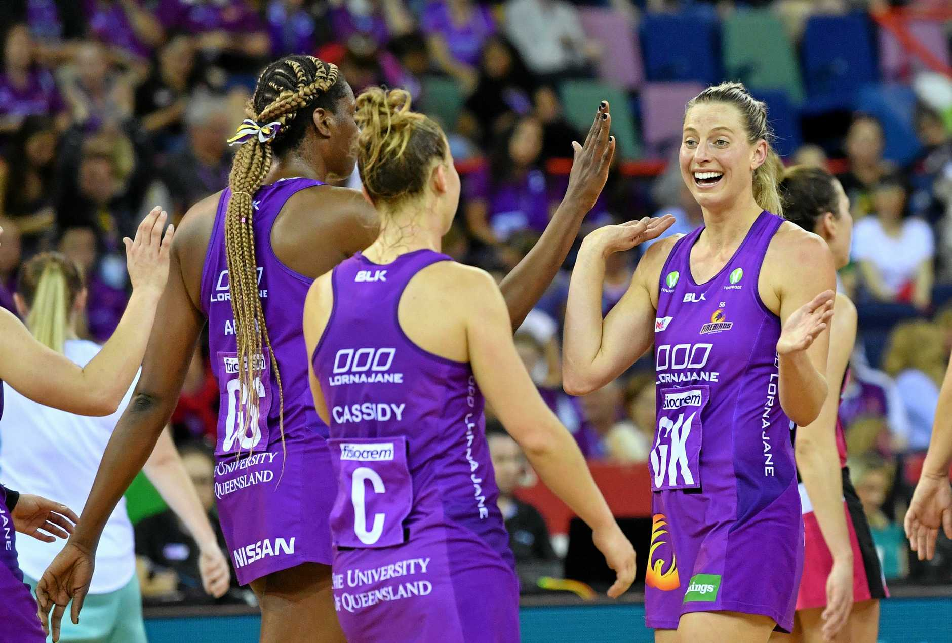 Laura Geitz (right) of the Firebirds is seen celebrating with team mates Romelda Aiken (left) and Mahalia Cassidy (centre) of the Firebirds during the Round 13 Super Netball match between the Queensland Firebirds and the Adelaide Thunderbirds this year.