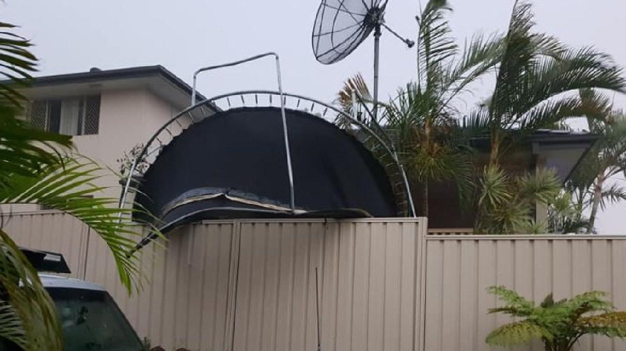 A neighbouring trampoline over a fence. Gold Coast storm. Photo: Lynley Schostakowski