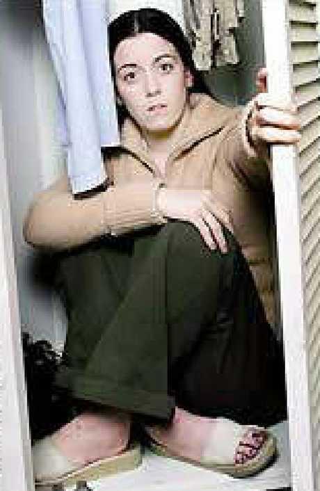 Natasha Ryan shows the cupboard at boyfriend Scott Black's Rockhampton home where she hid.