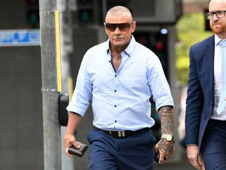 """Convicted armed robber, dubbed """"The General"""" of the infamous Angry Gang, Allan McQueen (left) arrives at the Coroners Court in Brisbane for the inquest. Picture: AAP Image"""