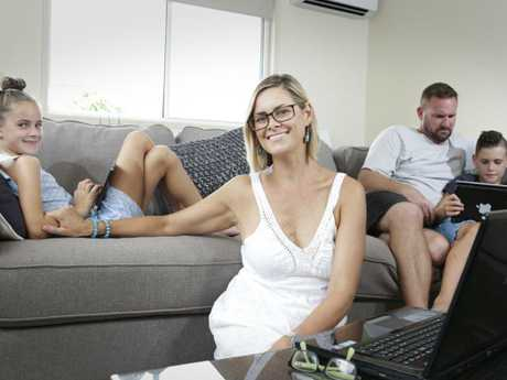 Kirri Dittmann at home with her family in Caloundra. They have a need for internet speed. Picture: Megan Slade