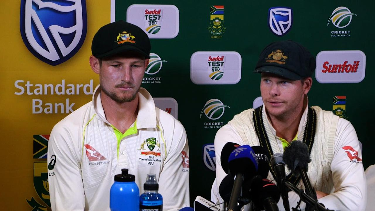 Cameron Bancroft and Steve Smith front reporters during a press conference in Cape Town on March 24 after the ball-tampering scandal. Picture: AFP