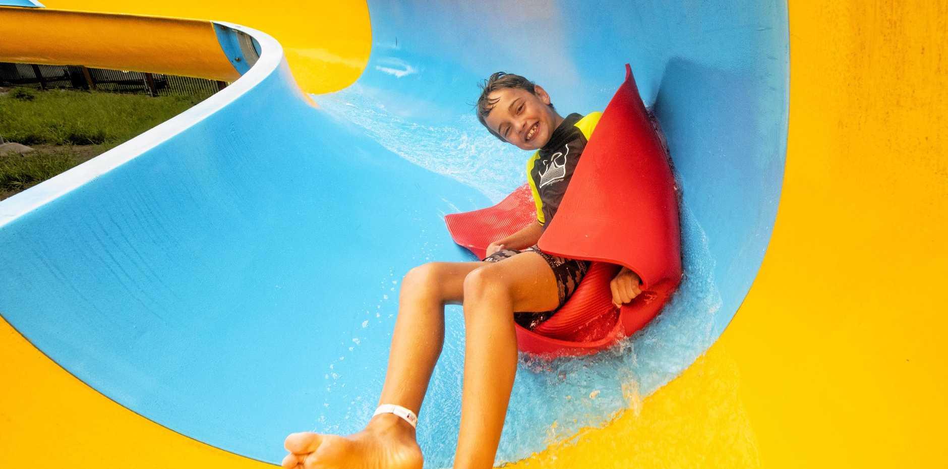 Bradley Stewart, 8 of Brisbane enjoys the newly opened waterslide at the Solitary Islands Marine Park Resort.