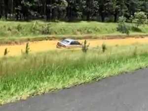 VIDEO: Car in ditch at Coochin Creek, Bruce Hwy a 'crawl'