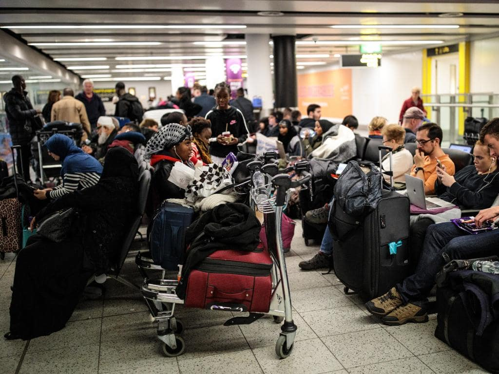 Passengers wait with their luggage in the South Terminal building at London Gatwick Airport after flights resumed today. Picture: Getty