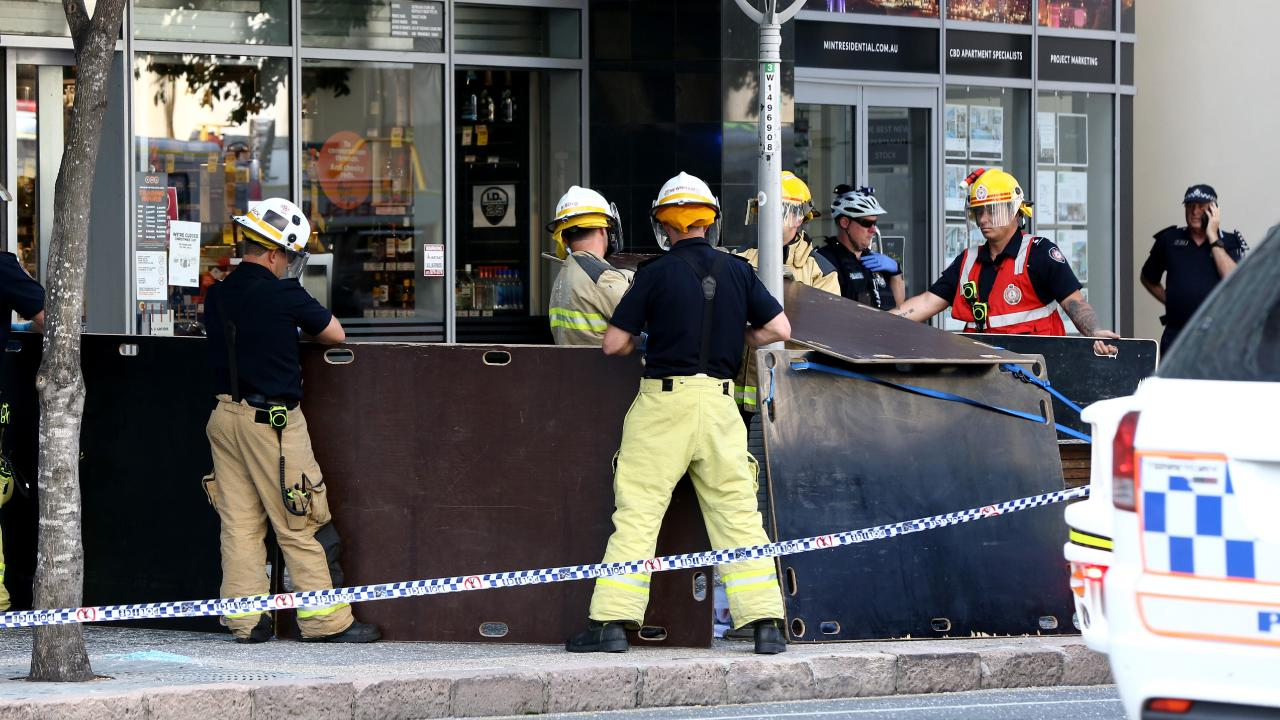 Emergency services at the scene where a woman plunged to her death at Aurora tower in Queen St, Brisbane. Picture: David Clark/AAP