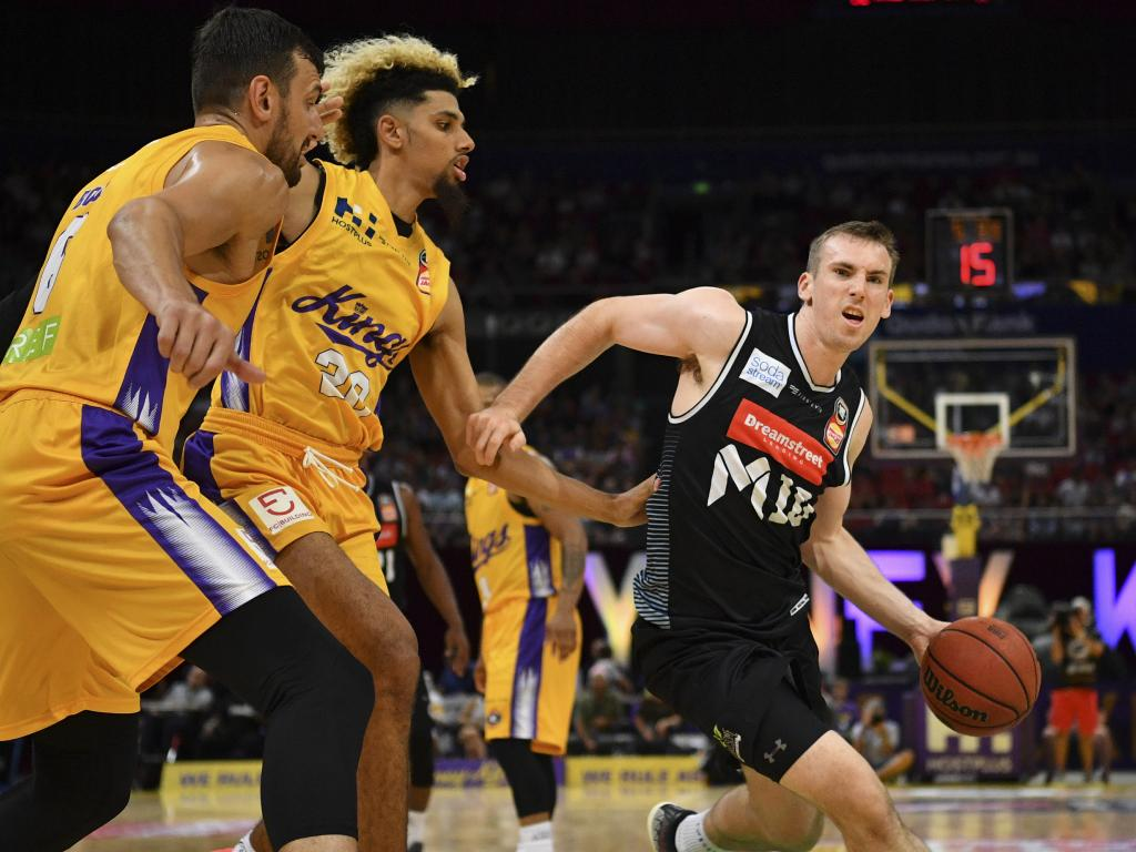 Melbourne United's Mitch McCarron (right) looks to get around Brian Bowen and Andrew Bogut (far left) of the Sydney Kings on Sunday. Picture: AAP