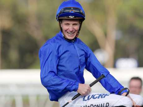 Jockey James McDonald returns to scale after riding Gongs to victory.