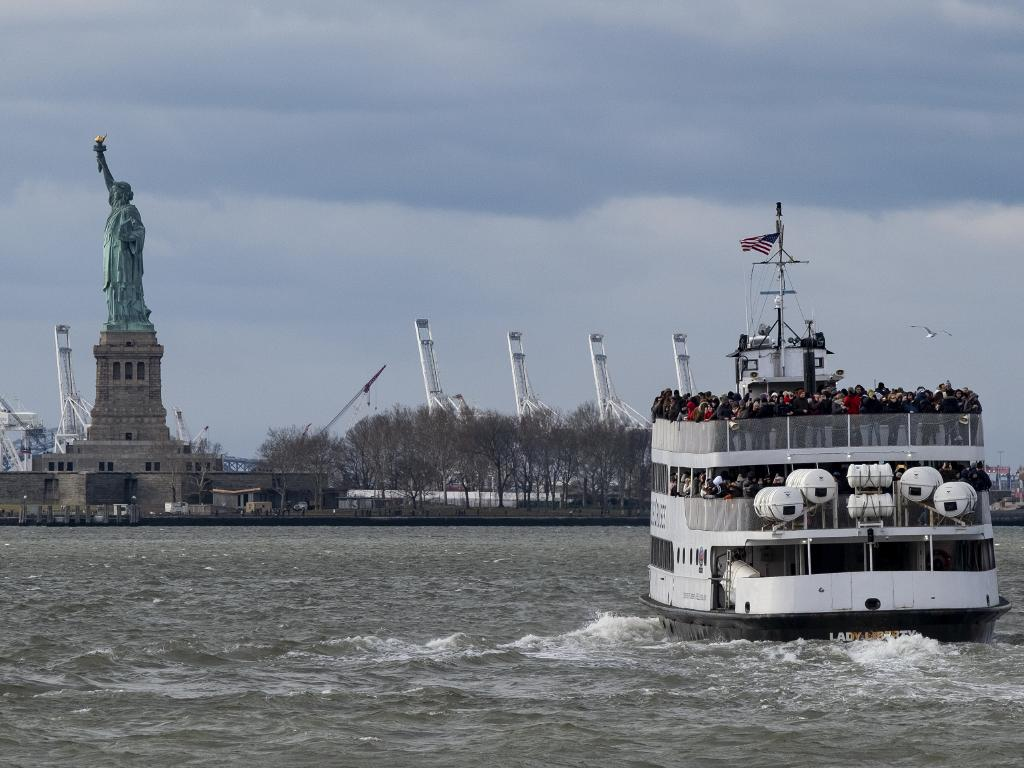 The Statue of Liberty, a National Park, remained open despite a partial government shutdown after New York Governor Andrew Cuomo made funding available. Picture: AP