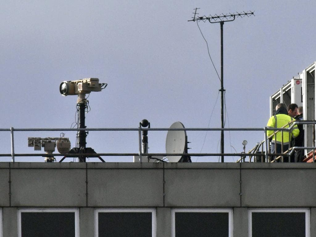 Counter drone equipment is deployed on a rooftop at Gatwick Airport in Gatwick, England. Picture: PA via AP