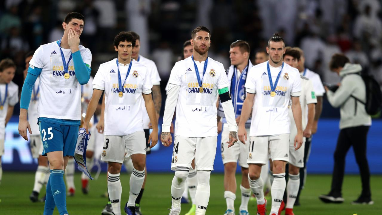 Real Madrid players with their winners medals
