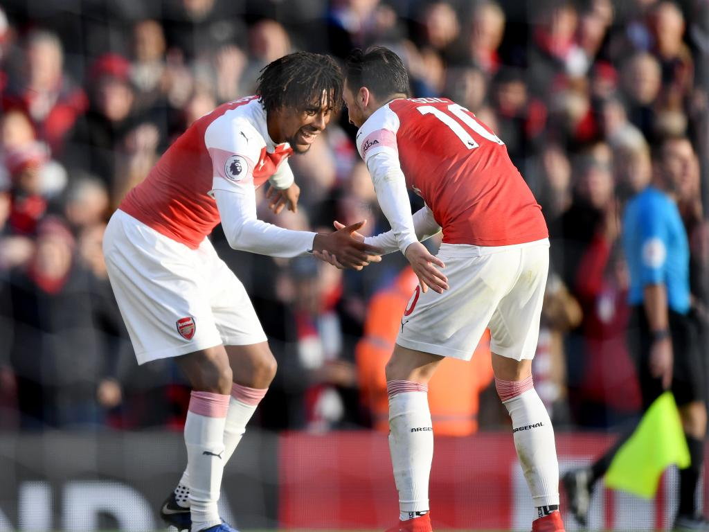 Alex Iwobi of Arsenal celebrates after scoring his team's third goal with Mesut Ozil of Arsenal during the Premier League match between Arsenal FC and Burnley FC. Picture: Getty Images