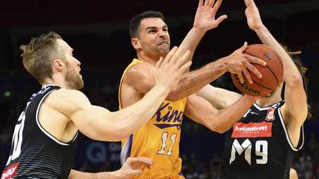 Sydney Kings guard Kevin Lisch drives between David Barlow (left) and Craig Moller of Melbourne United on Sunday. Picture: AAP
