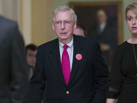 Senate Majority Leader Mitch McConnell walks back to his office as they work to pass a bill to pay for a border wall and avert a partial government shutdown. Picture: AP