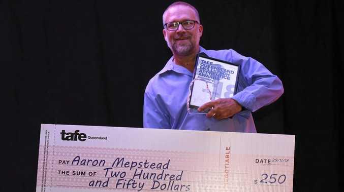 DEDICATED: Aaron Mepstead accepts his award.