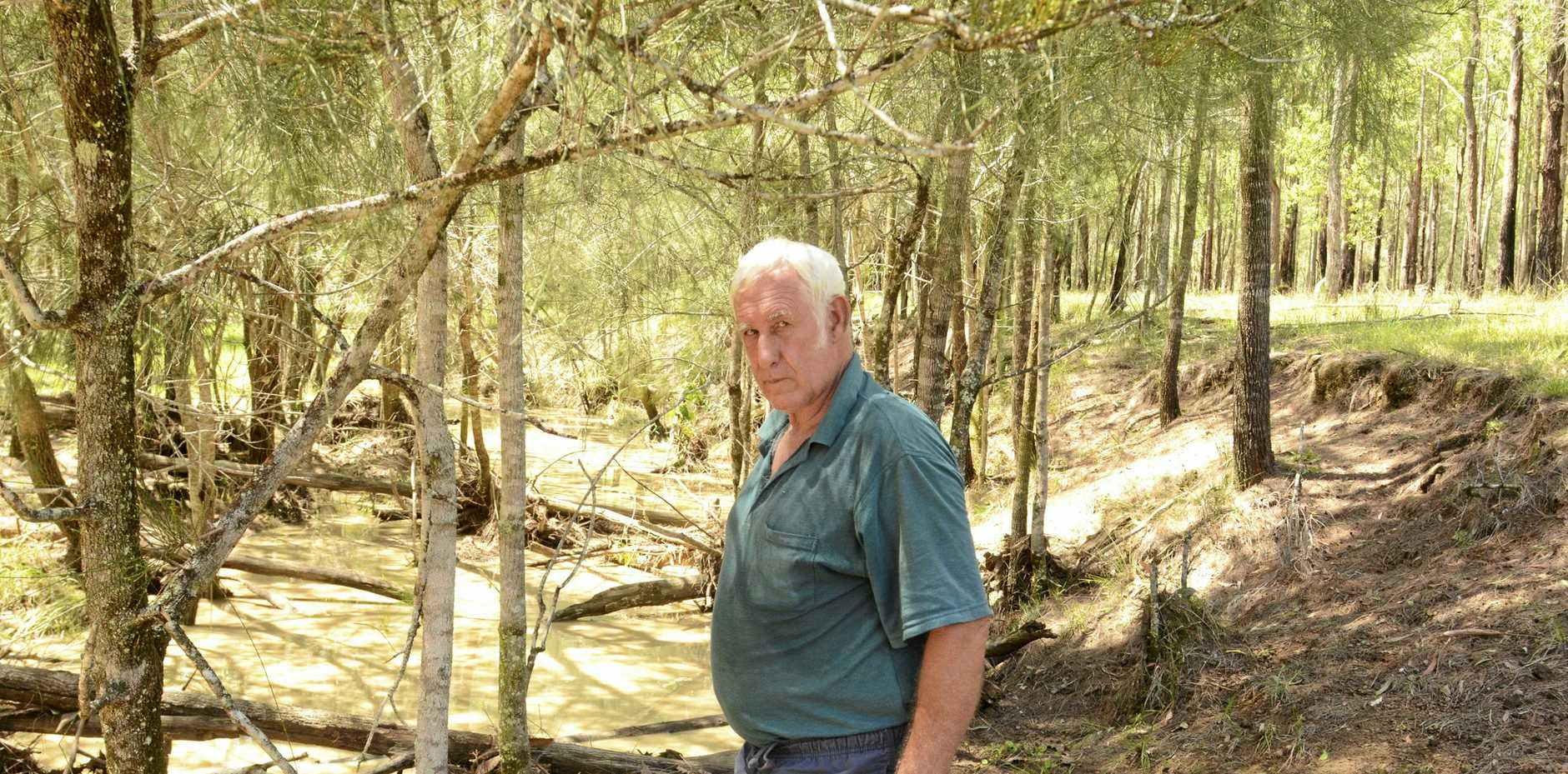 CONCERNS: Six Mile Ln landowner George Want near the creek he claims has been dirtied by discharge from the constructionof the Clarence Correctional Centre.