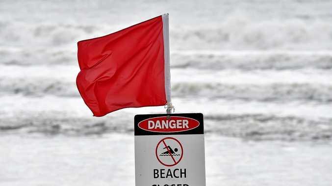 Beach closed sign.