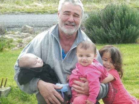 Chris with his grandchildren. Picture: New Zealand Herald