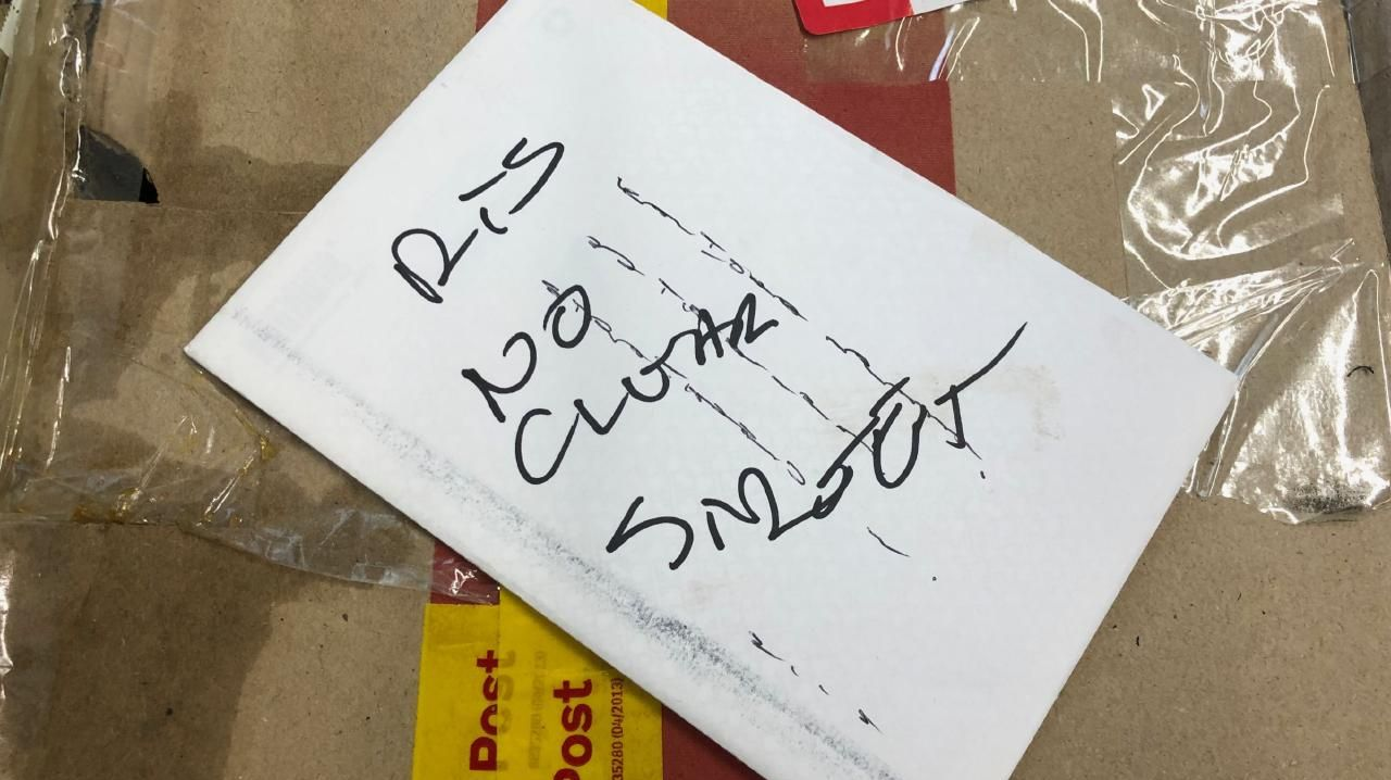 Indecipherable. Poor handwriting is a classic reason why mail ends up at the dead letter office.