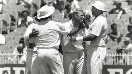 Shane Warne is congratulated by teammates after taking a wicket during the 1992 Boxing Day Test against West Indies.