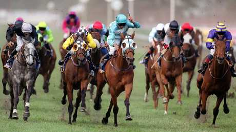 Rogan Josh (c) ridden by jockey John Marshall wins the 1999 Melbourne Cup.