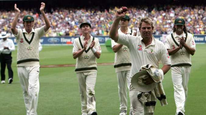 Shane Warne leaves the field and acknowledges the adoring crowd.