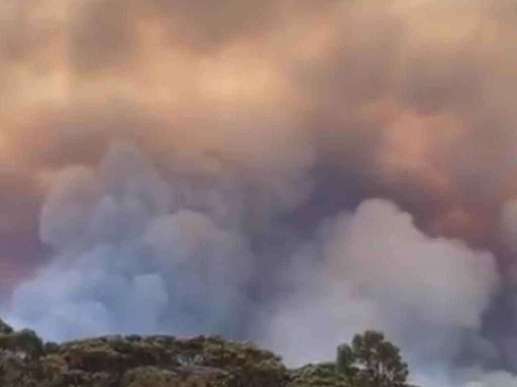 """The blaze is threatening """"homes and lives"""". Picture: DFES"""