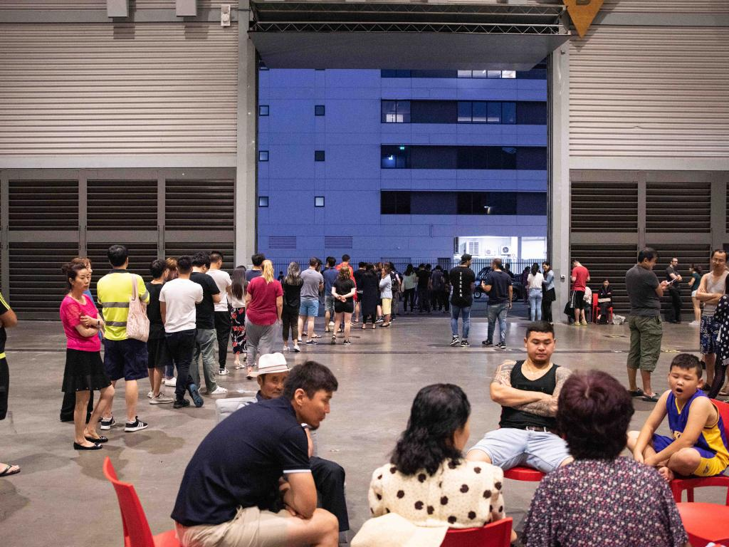 Opal building in Olympic park Collapse Evacuees photographed inside of the exhibition hall where they are staying. 24 Dec 2018 (Flavio Brancaleone-Daily Telegraph)